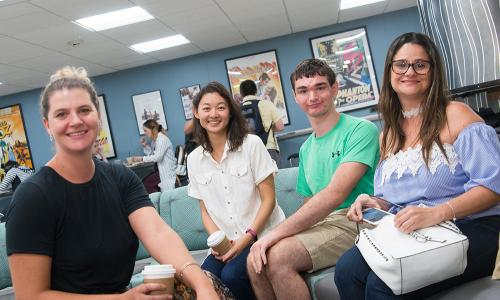 four students sitting in welcome center