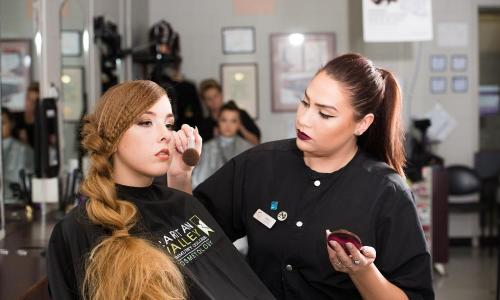cosmetology student working on model