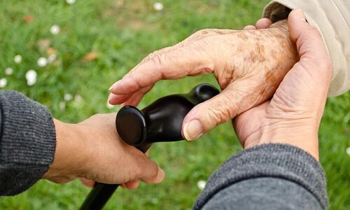 helping older hands on cane