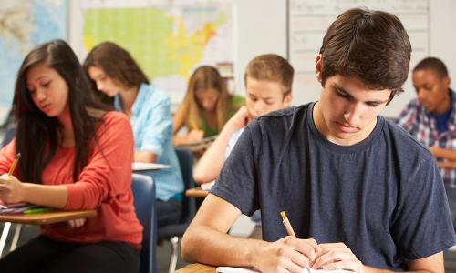class of students taking a test