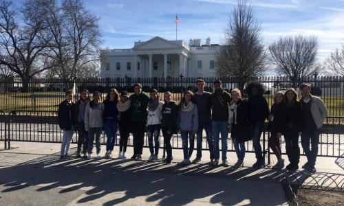 group of students in front of capitol