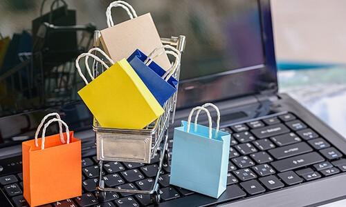 shopping bags on laptop