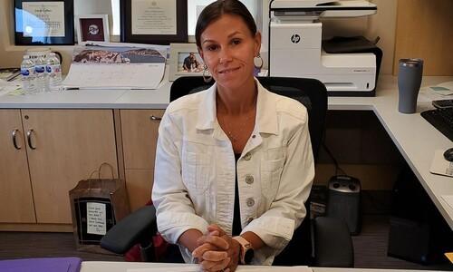 Joanie Coffaro at her desk