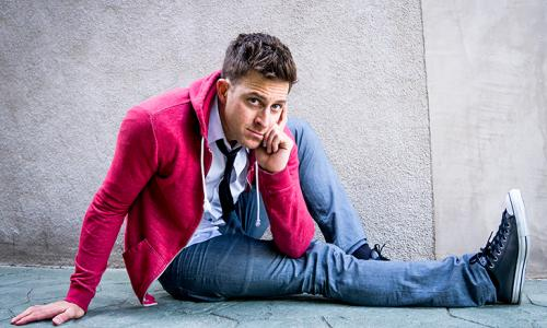 K-von comedian sitting on ground