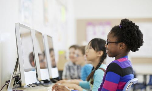 row of kids at computers