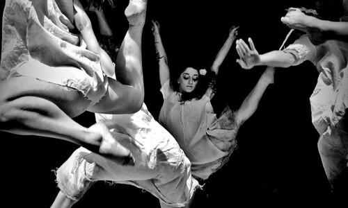 dancers leaping in air