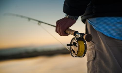 man holding fly fishing pole