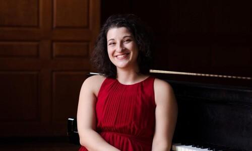 margarita rovenskaya with back toward piano