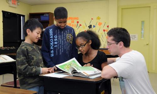 3 children with rvcc male student tutoring them
