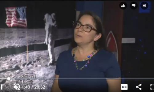 amie gallagher with moon landing photo