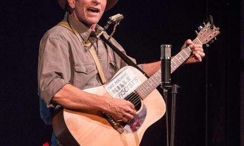 Randy Noojin as Woody Guthrie