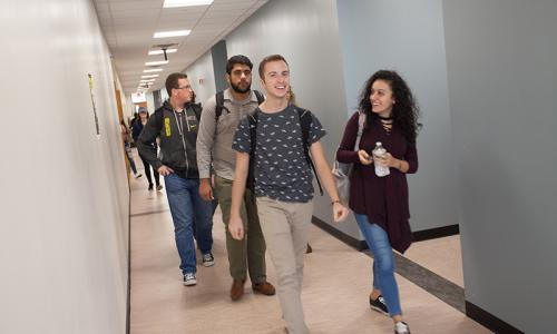 group of students walking in hallways