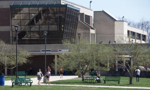 campus photo outside with faculty, staff and students