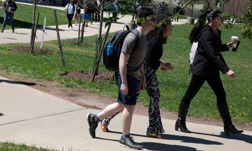 students walking on campus in springtime
