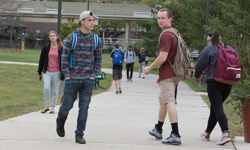 students walking outside on path