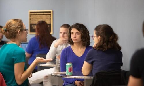 students sitting at tables near brew ha ha