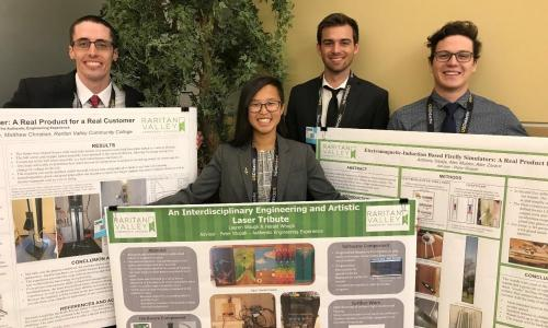 engineering students with posters at national conference
