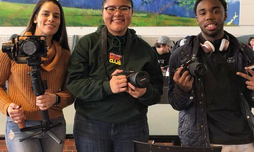 3 students with cameras and microphones