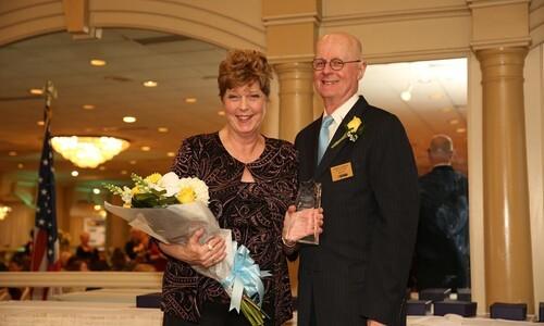 Carol Patterson with award and John Lanier