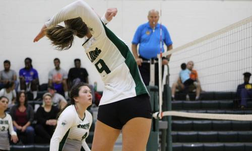 female volleyball player jumping in air
