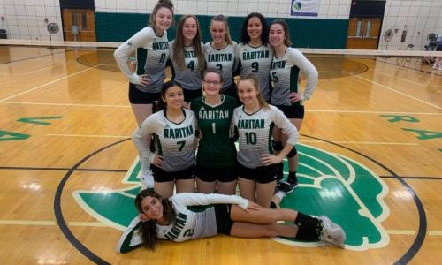 group pic of women's volleyball team in gym