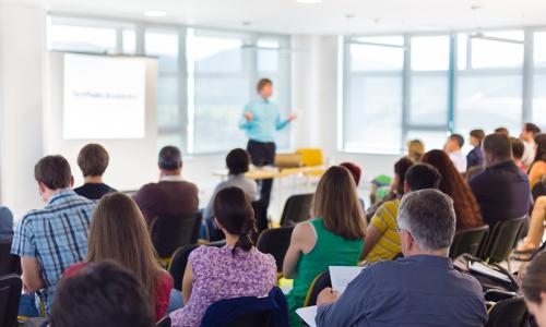backs of people at seminar