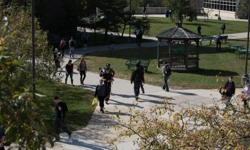 many students walking outside on campus