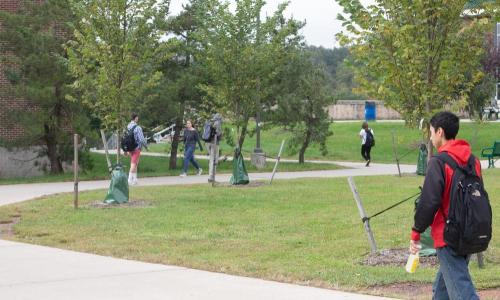 students walking on campus outside