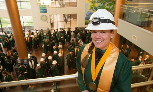 female graduate in hard hat