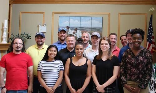 students with WB Mason execs at golf classic